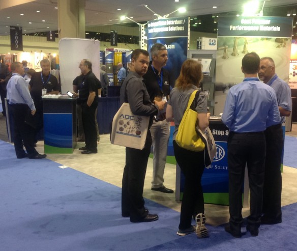 Hustle and bustle the words for Huber's booth this morning at CAMX 2014!