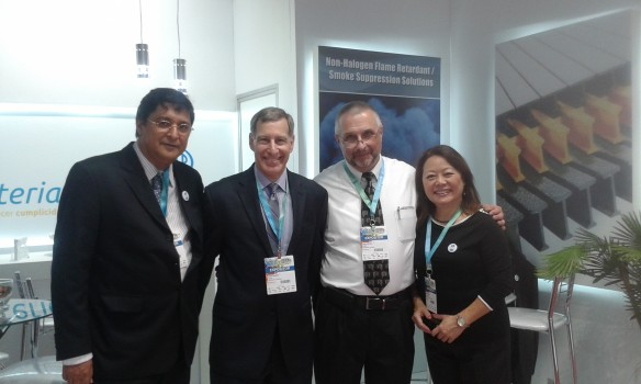 Huber exhibiting with its friends at Raw Material Comercio during the FEIPLAR Composites Exhibition.  Pictured (from left) are Aluisio Abreu of Raw Material Comercio; Mitch Halpert and Gary Rex, Ph.D., of Huber Engineered Materials; and Marina Tsuda of Raw Material Comercio.