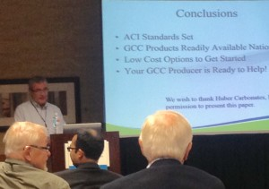Huber's Lane Shaw (background) discusses the multifaceted benefits of limestone in concrete formulations at last week's ACI Fall Convention & Expo in Denver.