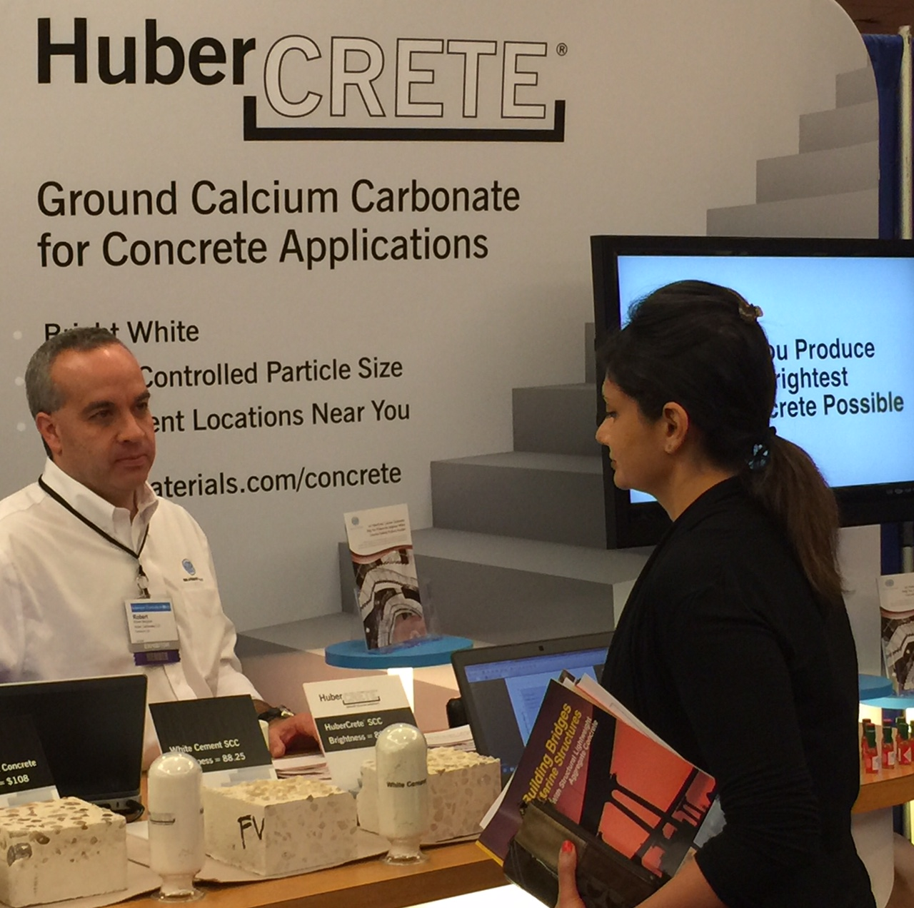 Huber's Bobby Bergman (left) explains the many benefits of HuberCrete® ground calcium carbonate with an attendee at the American Concrete Institute's (ACI) Fall Convention and Expo.